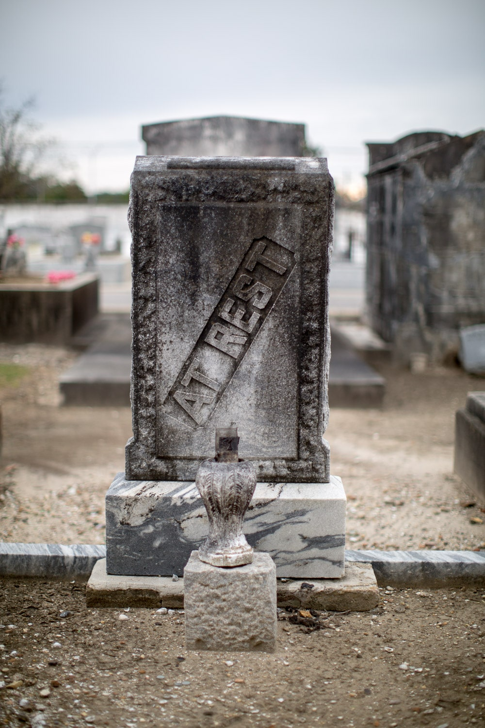"""At Rest"" gravestone in a New Orleans cemetery"